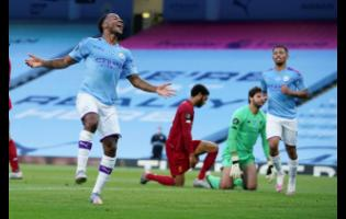 Manchester City's Raheem Sterling celebrates after scoring his team's second goal against Liverpool during their English Premier League match at Etihad Stadium in Manchester, England, Thursday, July 2, 2020.