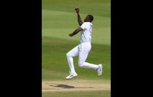 West Indies' captain Jason Holder bowls during the fifth day of the first cricket Test match between England and West Indies, at the Ageas Bowl in Southampton, England, Sunday, July 12, 2020.
