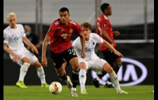 Manchester United's Mason Greenwood (left) controls the ball during their Europa League quarter-final match against Copenhagen at the Rhein Energie Stadium in Cologne, Germany, yesterday.