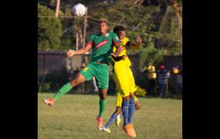 File Humble Lion's Andre Clennon (left) jumps high for a ball with Vere United's Kenroy Lumsden during their Red Stripe Premier League game at the Wembley Centre of Excellence in Hayes, Clarendon on Sunday, December 15, 2019.