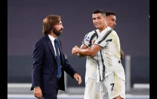 Juventus' coach Andrea Pirlo (left) and Juventus' Cristiano Ronaldo (right) on the field during an Italian Serie A soccer match between Juventus and Sampdoria at the Allianz stadium in Turin, Italy, on Sunday, September 20, 2020.