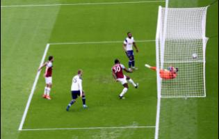 West Ham's Michail Antonio, third left, scores his side's opening goal during the English Premier League match between West Ham United and Tottenham at the London Stadium in London, Saturday, February 21, 2021.