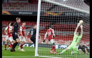 Slavia Prague's Tomáš Holeš (bottom right) scores his side's goal during their Europa League quarter-final match against hosts Arsenal at Emirates Stadium in London on Thursday.