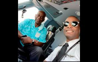 Anselm Dewar (right) and his father, Ashman, in the pilot's cockpit, aboard the flight on June 5.