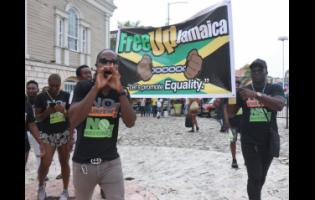 Some members of the entertainment fraternity in Montego Bay stage a peaceful protest on St James Street last Saturday.