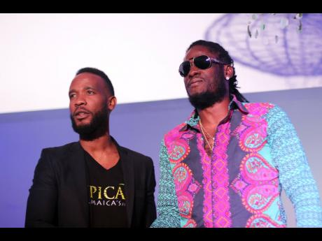 PHOTO BY STEPHANIE LYEW Head of marketing at Epican Jermaine Bibbons (left) stands with dancehall entertainer Aidonia, the new ambassador for the cannabis brand.