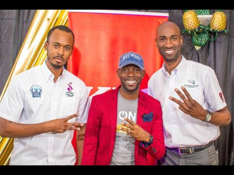 Brian Cuff (left) Sterling Gospel Awards co-founder, and Andrei Roper (right) brand manager of KFC, hang with gospel singer Rondell Positive at the launch of the 2019 awards .