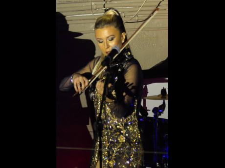 Orisha Pelzer of Orisha Sound displays her violin skills at Usain Bolt's Tracks and Records recently.
