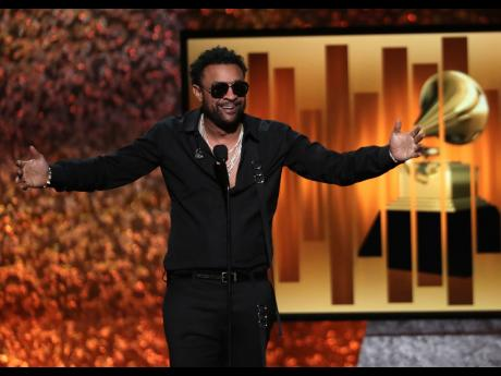ap Host Shaggy speaks at the 61st Annual Grammy Awards on Sunday.