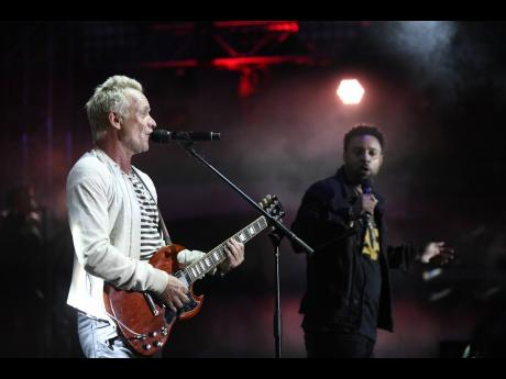 Sting (left) and Shaggy in performance at last year's Shaggy and Friends concert on the lawns of Jamaica House.
