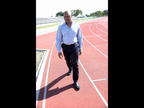 Lionel Rookwood Acting principal at G.C. Foster College of Physical Education and Sport Maurice Wilson making his way along the institution's athletics track recently.