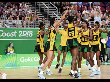 Members of Jamaica's Sunshine Girls team react after a win at the Commonwealth Games in Gold Coast, Australia, where they won the bronze medal in April 2018.