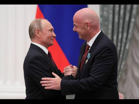 Russian President Vladimir Putin (left) shakes hands with FIFA President Gianni Infantino during an award ceremony at the Kremlin in Moscow, Russia, yesterday.