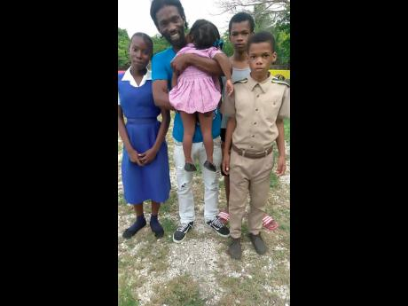Kenrick Spencer with his  stepdaughter and three of his four children.