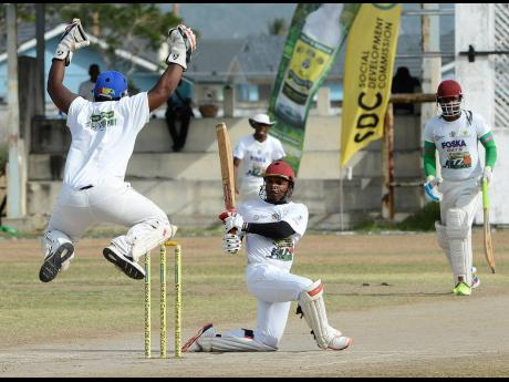 Action between Old Harbour and Johnson Mountain during the Social Development Commission/Wray and Nephew National T20 match at Chedwin Park, St Catherine, on Sunday.