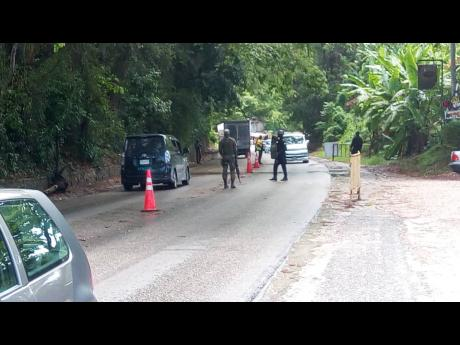 Security forces man a checkpoint in western Jamaica.