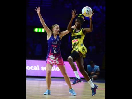 Jamaica's Nicole Dixon (right) gets aerial ahead of Scotland's Claire Maxwell.