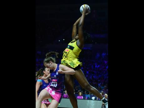 Jamaica captain Jhaniele Fowler's (right) physical presence is too much for Scotland's Emily Nicholl as she outjumps her to claim a pass.