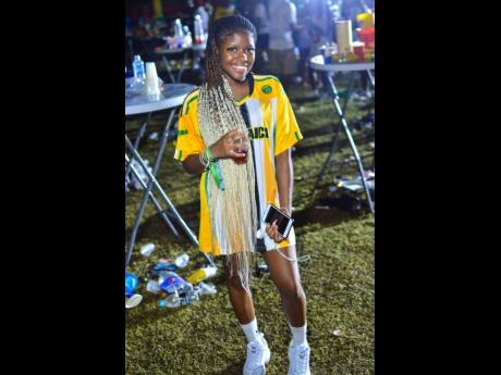 Little Miss delights in a Jamaica Reggae Girlz jersey.