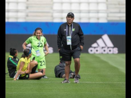 Jamaica senior women's football team head coach Hue Menzies (right) and members of his team during a training session at the FIFA Women's World Cup in France last summer.