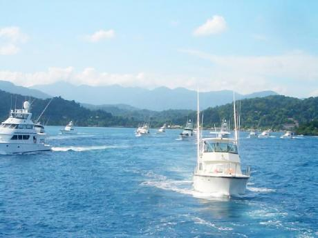 Boats sail out into the sea during the Port Antonio Blue Marlin tournament last year.