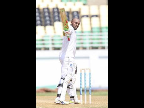 "File photos left: Windies 'A' batsman Sunil Ambris hails applause for his hundred against Sri Lanka 'A' on the second day of the first ""Test""  at the Trelawny Multipurpose Stadium in October 2017."