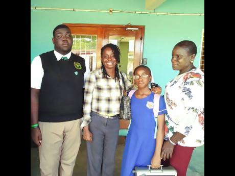 Kimani Nunis (left) is joined by (from second left) Jennifer Jarret, guidance counsellor at Calabar High School, Destiny Morrison and Winsome Blair.