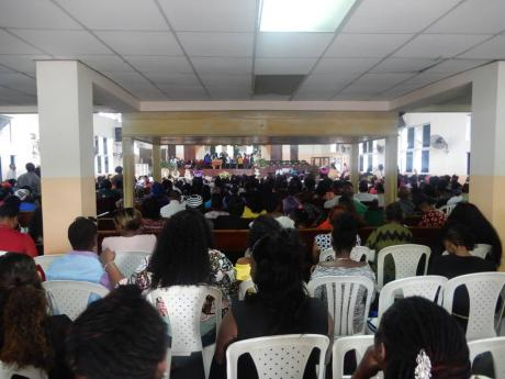 Mourners attend the funeral of Radcliffe 'Krazy' Burger yesterday at the Pentecostal Tabernacle in Kingston.