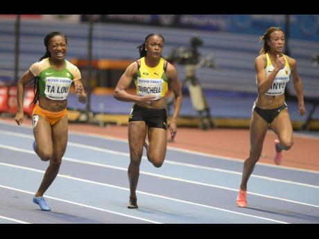 Jamaica's Remona Burchell (centre) battles Ivory Coast's Marie-Josee Ta Lou (left) and Germany's Tatjana Pinto at the World Athletics Indoor Championships in Birmingham, England, on Friday, March 2, 2018.