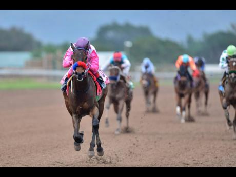 LOOSE BALL (Jerome Innis) wins last Saturday's ninth race at Caymanas Park. The three-year-old gelding is owned by Elizabeth DaCosta and trained by her husband, Wayne.