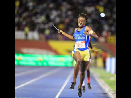 Anchor leg runner Charokee Young celebrates as she crosses the finish line to gain victory for Hydel High in last year's 4x400m open final at the ISSA/GraceKennedy Boys and Girls' Athletics Championships.