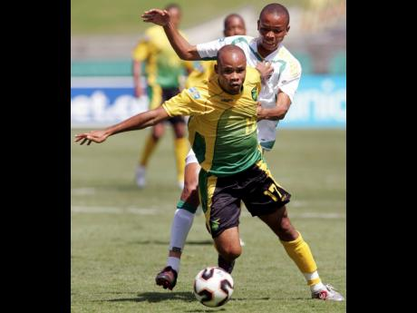 Jamaica's Jermaine Hue breaks away from South Africa's Nkosi during the second half of their CONCACAF Gold Cup match in 2005. Hue scored Jamaica's opening goal in a 3-3 draw.