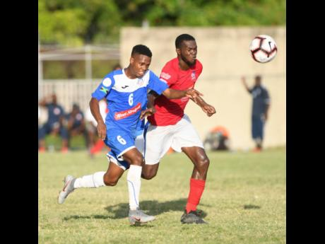Portmore's Lamar Walker (left) in a foot race with Dunbeholden's Graeme Green during their Red Stripe Premier League encounter at the Spanish Town Prison Oval on Sunday, December 1, 2019.