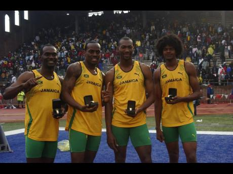 File Photos Members of the victorious Jamaica senior national team pose with their Penn Relays watches after winning the men's Olympic Development 4x400m relay on Saturday, April 30, 2005.