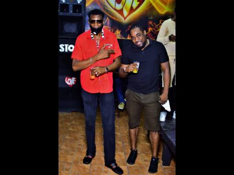 Father Wee Pow (left) with producer Earthman at Weddy Weddy Wednesdayz, at Stone Love Headquarters at 41 Burlington Avenue, in Half-Way-Tree, St Andrew earlier this month.