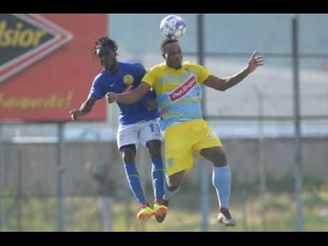 Waterhouse's Shawn Lawes (right) wins an aerial duel against Vere United's Devroy Grey during their Red Stripe Premier League game at the Drewsland Stadium on Thursday, September 12, 2019.