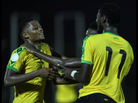 File Reggae Boyz striker Leon Bailey (left) celebrates with  Devon Williams (partially hidden) and Shamar Nicholson during Jamaica's Concacaf Nations League match against Antigua and Barbuda at the Montego Bay Sports Complex on September 6, 2019.