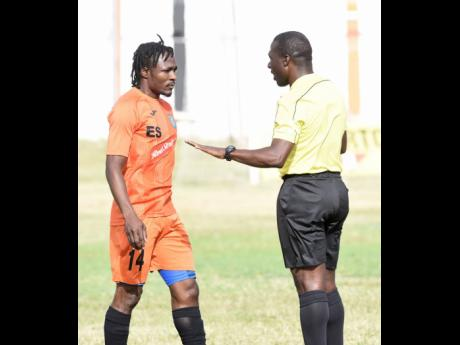 A local referee warning Tivoli's Kemar Flemmings about his conduct during a National Premier League match at the Edward Seaga Sports Complex on Sunday, January 19.