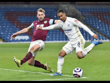 Burnley's Charlie Taylor (left) in action with Leicester's Youri Tielemans during the English Premier League match between Burnley and Leicester City at Turf Moor stadium in Burnley, yesterday.