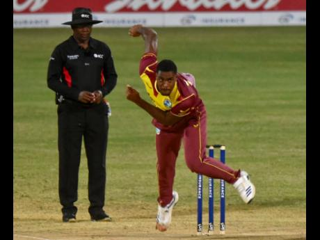 Obed McCoy bowls a delivery as he put together a spell of two wickets for 25 runs against Sri Lanka in the first T20I yesterday.