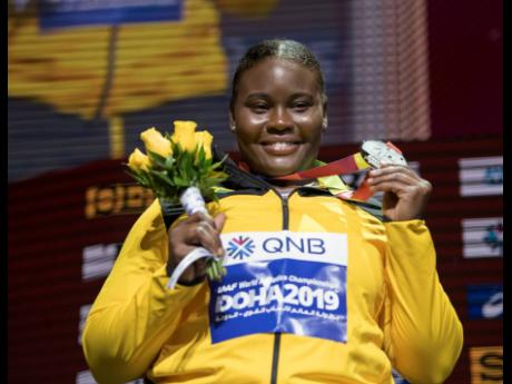 Danniel Thomas-Dodd smiles as she shows off her silver medal during the medal presentation for the women's shot put  at the 2019 IAAF World Athletic Championships held at the Khalifa International Stadium in Doha, Qatar, on Friday October 4, 2019.