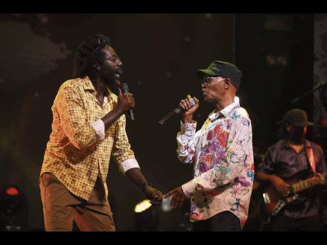 Beres Hammond (right) and long-time friend Buju Banton in performance.